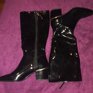 Zara black patent leather boots with gold accent.